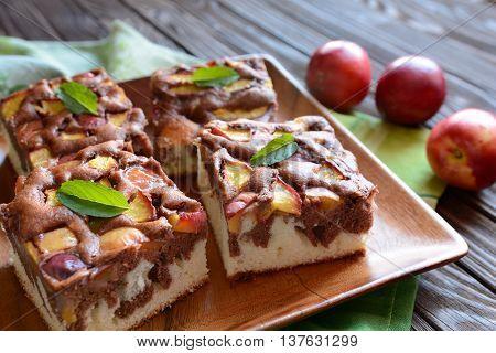 Nectarine sponge cake on a wooden background