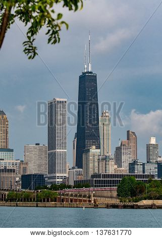 Chicago United States: May 26 2016: Hancock Tower Below Tree Branch
