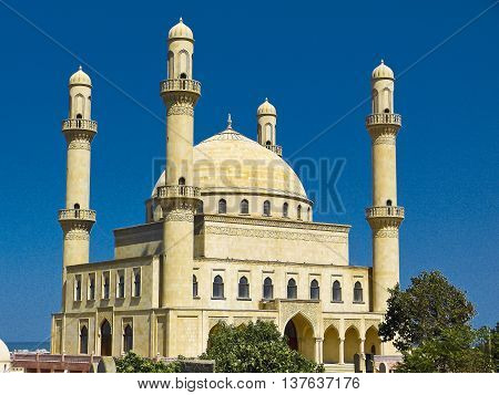 The huge 1990s Rehime Khanim mosque, built above the grave of sister of the 7th Shiite Imam, is the spiritual heart of conservative Nardaran settlement north of Baku, Azerbaijan.