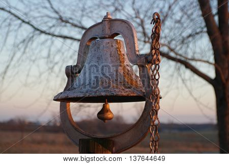 Large rural silver metal weathered farm bell
