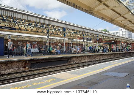 Basingstoke/UK. 3rd July 2016. Platform 3 at Basingstoke station with passengers awaiting the departure of a London Waterloo service.