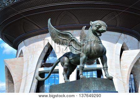 Kazan, Tatarstan, Russia - July 6, 2016. Kazan Central Wedding Palace. Sculpture winged Bars - symbol of Tatarstan. Sculptor Dashi Namdakov.