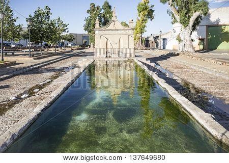 Pilar de los Llanos ancient stone made water fountain in Hinojosa del Duque, Córdoba, Spain