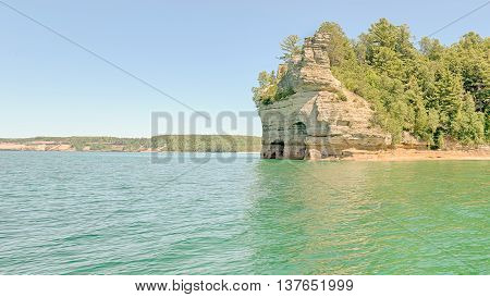 Miners' Castle on Lake Superior is a named formation in Pictured Rocks National Lakeshore, near Munising, Michigan. Mineral seepage creates the colors: Red and orange are iron, green and blue are copper, black is manganese and white is lime.