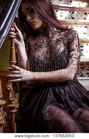 Beauty fashion woman portrait wearing black designer top with perfect smokey makeup