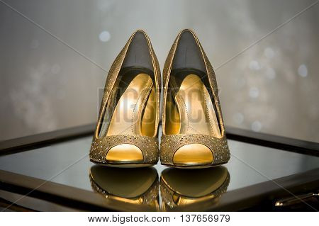 Close up of bridal wedding shoes during pre ceremony preparations