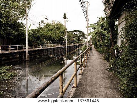 Concrete Walk way along the sewage water canal