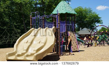 MONTVILLE, CT - JUN 18: Playground at the Dinosaur Place at Nature's Art Village in Montville, Connecticut, as seen on Jun 18, 2016. The park features over 40 life-sized dinosaurs.