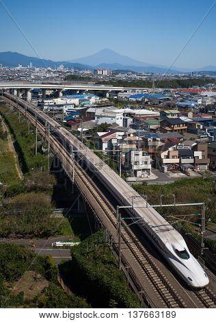 Shizuoka - OCT 08: Shinkansen bullet train and Mountain Fuji on OCT 08 ,2015 , Shizuoka ,Japan. Shinkansen is world's busiest high-speed railway operated by four Japan Railways companies.