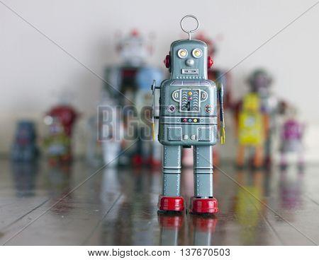robot toy standing on wooden floor