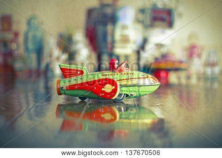 Rocket toy on wooden floor toned image