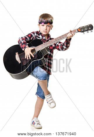 Boy Stands On One Leg And Playing The Guitar - Isolated On White Background