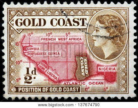 LUGA RUSSIA - JUNE 25 2016: A stamp printed by GOLD COAST shows image portrait of Queen Elizabeth II against position of Gold Coast on Africa map circa 1953