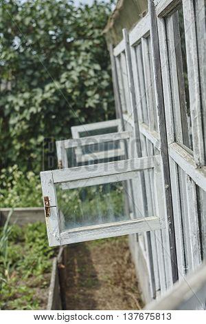 Open ventilator window in hothouse close up