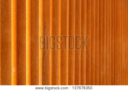 indistinct texture of rusty iron pipes of red color for a background