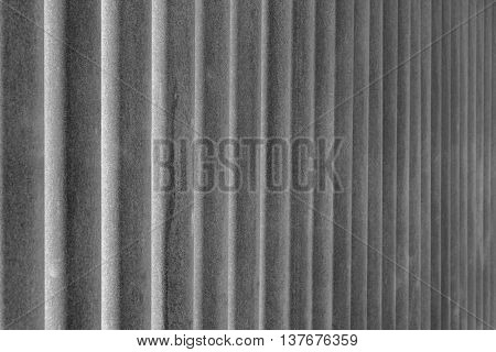 indistinct texture of rusty iron pipes of gray color for a background