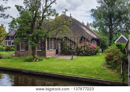Giethoorn Netherlands - June 29: known for its bridges waterways thatched cottages and punters. It is also called the 'Dutch Venice' and known to the world Monopoly edition, June 29, 2016 in Giethoorn, Netherlands.