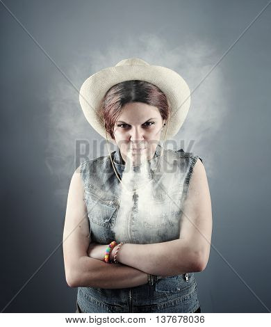 Angry women briging smoke out of her nose .