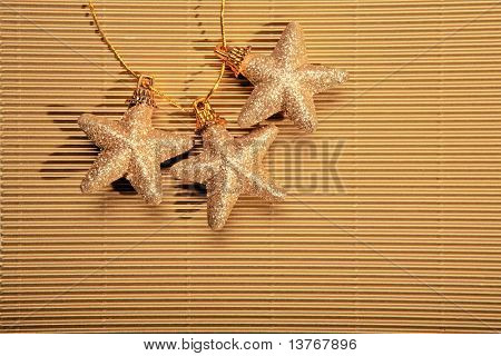 Christmas three star on a golden background