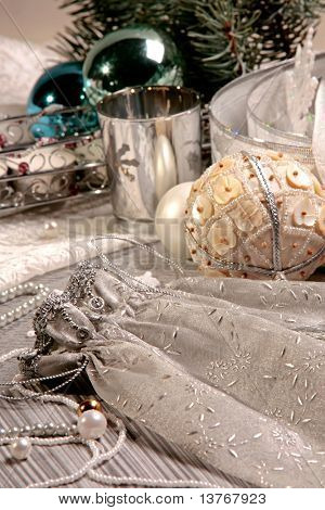 Creative image of gift sack on the background of Christmas details