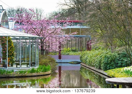 Lisse, Netherlands - April 4, 2016: Pavillion Willem Alexander and flower blossom in dutch park spring garden Keukenhof Lisse Netherlands