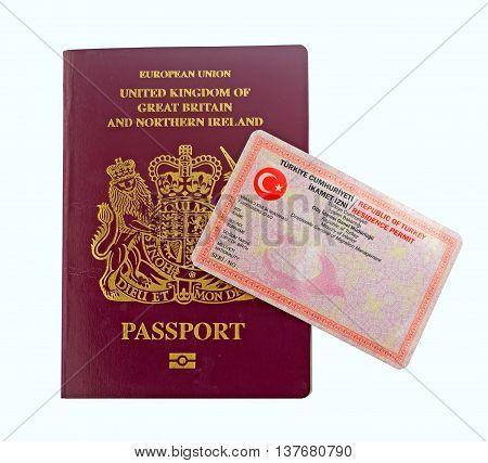 British passport and Turkish residence visa isolated on white