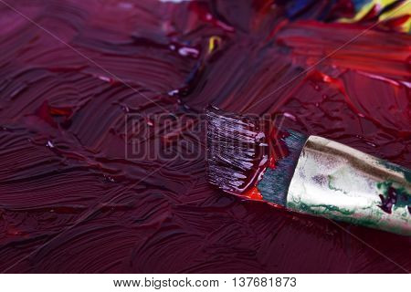 Dirty Paint Brush In Mixed Purple Paint