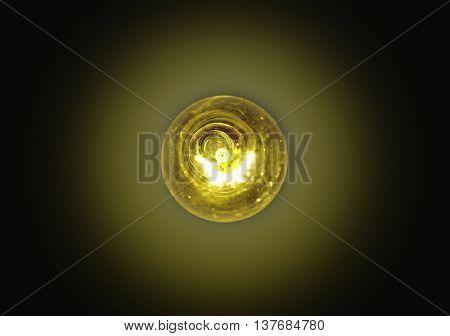 light bulb lit on a black backgroundsoft focus