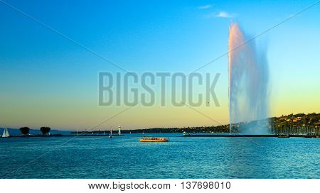 View Of Jet D'eau And The Public Transport Boat In Geneva, Switzerland