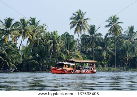Tourist boat at Kerala backwaters Alleppey India. It's a chain of lagoons and lakes near Arabian Sea (Malabar Coast) of Kerala state in southern India