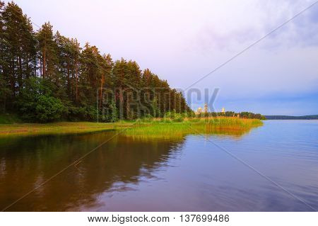 Early morning on lake Seliger. View of the monastery of the Nilo-Stolobenskaya Pustyn.