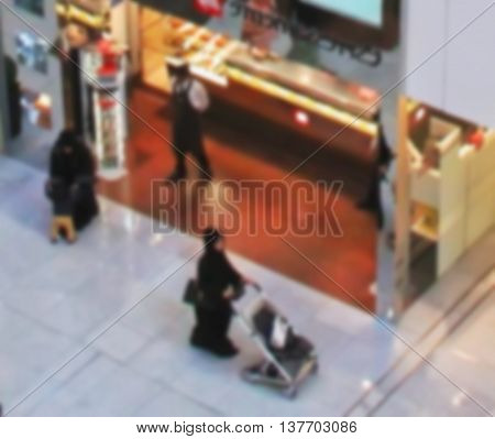 Shopping Center, Arab Sheikhs Men And Their Wives And Families In A Mall Make A Purchase, People Go
