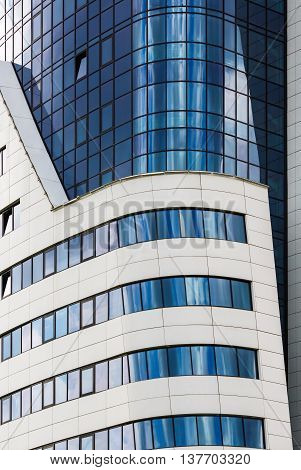 MINSK BELARUS - MAY 03 2016: Renaissance Minsk Hotel - this is the first hotel of the well-known international hotel chain Marriott in Belarus. Close-up of modern building of steel and glass.