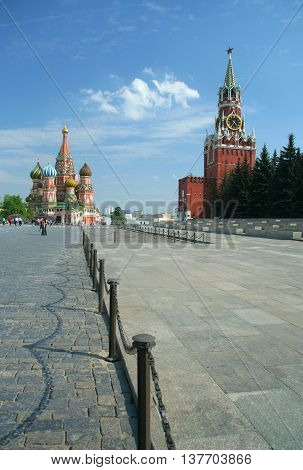 Kremlin tower with chime on the red square and The Cathedral of Intercession of the Virgin on the Moat , Moscow, Russia