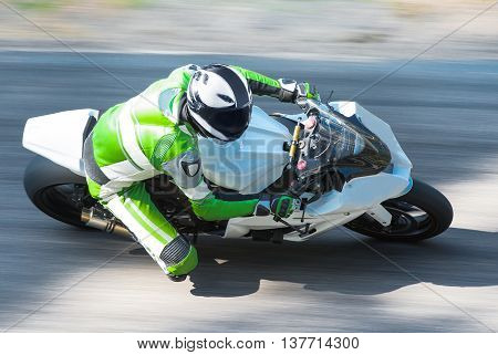 Dynamic and realistic motorbike racing on bright summer background