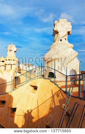 Roof With Chimney And Tourists In Casa Mila Building