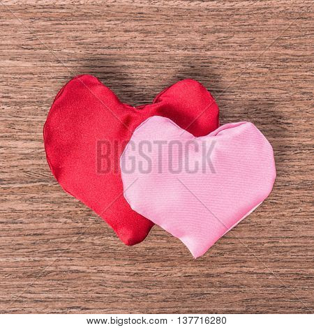 Two Red And Pink Hand-sewn Heart On Wooden Background, Concept Valentine's Day, Greeting Card, Close
