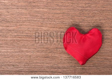 Top View Of One Red Homemade Sewn Heart On Wooden Background, Concept Valentine's Day, Greeting Card