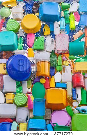 Background from plastic ware - bowls bottles buckets canisters etc.