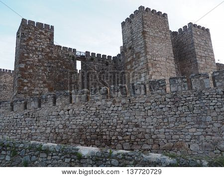Castle and stone walls with crenellations in the old town of Trujillo, Spain