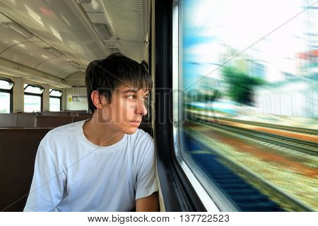 The Pensive Teenager sit in the Train