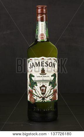READING MOLDOVA APRIL 8 2016. One bottle of Jameson Whiskey Triple Distilled 40% 1 Liter on black background. Blended whiskey is imported from Ireland