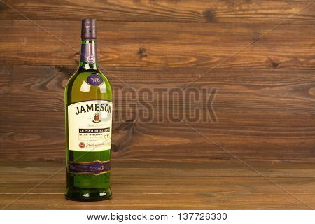 READING MOLDOVA APRIL 8, 2016. One bottle of Jameson Whiskey Triple Distilled 40% 1 Liter on black background. Blended whiskey is imported from Ireland