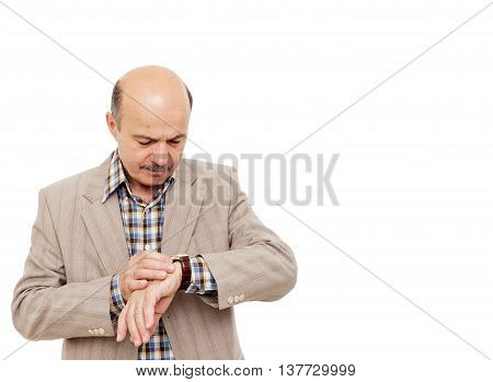 businessman checks the time on the clock. late for a meeting