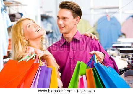 Portrait of enjoying woman with her boyfriend near by