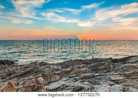 Natural rock with seacoast and beautiful sky background after sunset