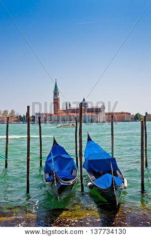 Gondolas on Grand Canal and San Giorgio Maggiore church in Venice Italy