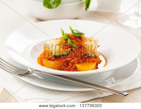 A dish of ajo colorao with bacalao a typical Spanish dish from the region of Andalucia especially the towns of Almería Córdoba and Málaga