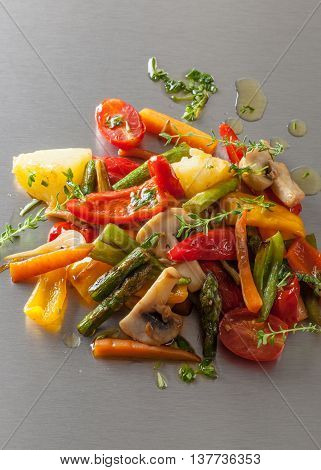 Grilled vegetables with spicy oil on a Japanese teppanyaki grill plate.