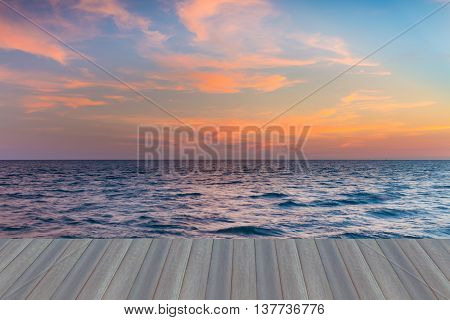 Opening wooden floor, Sunset sky over seacoast natural background